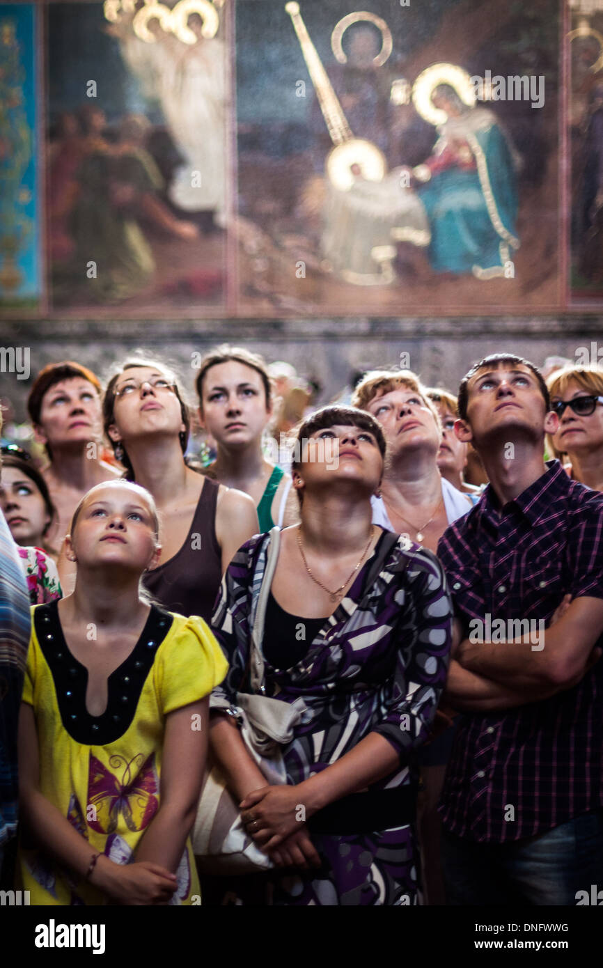 Visitors admire an Orthodox church ceiling in Moscow, Russia. Stock Photo