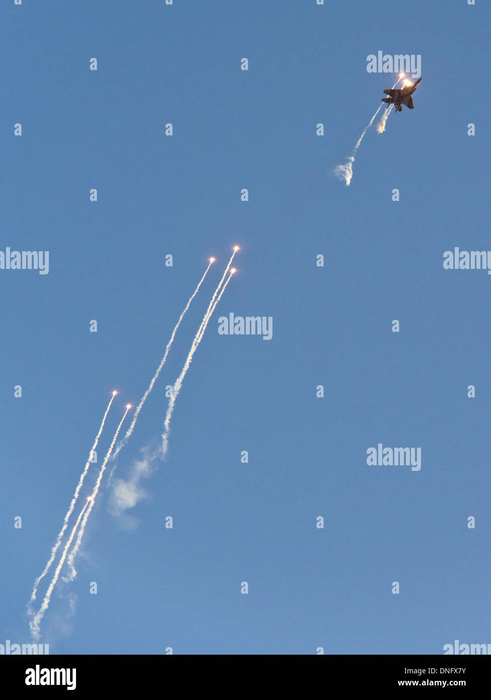 Hazerim, Israel. 26th Dec, 2013. An Israel Air Force F-15i releases flares as a defensive countermeasure against Stock Photo
