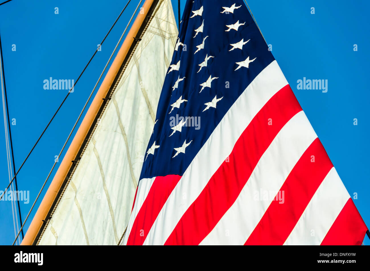 Large American Flag attached to a sail on a ship named the Star of India. San Diego, California, United States. - Stock Image