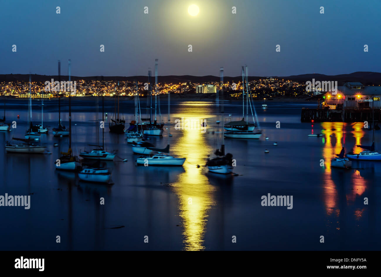 The Moon rising over Monterey Bay. Monterey, California, United States. - Stock Image