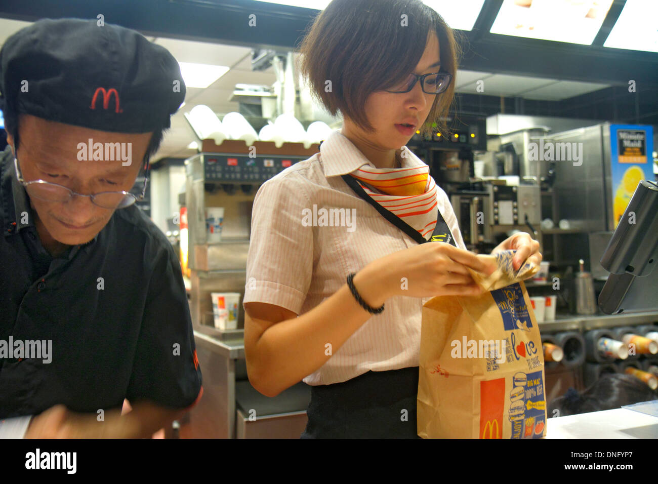 Hong Kong China Island Fortress Hill King's Road McDonald's fast food restaurant counter manager employee Asian Stock Photo
