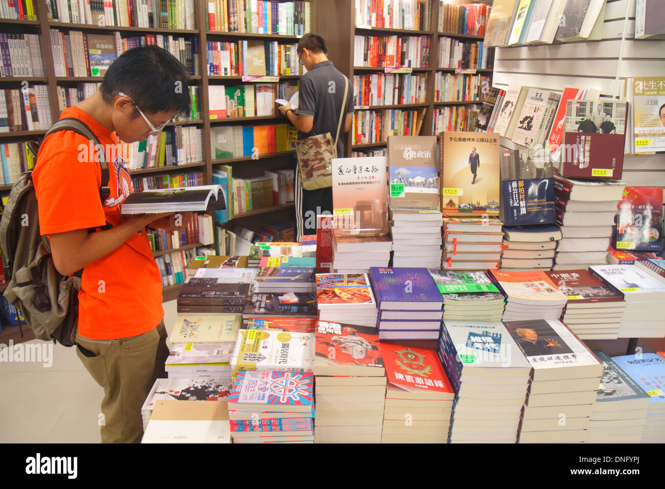 Hong Kong China Island Causeway Bay Yee Wo Street bookstore books sale display customer browsing Asian man Stock Photo