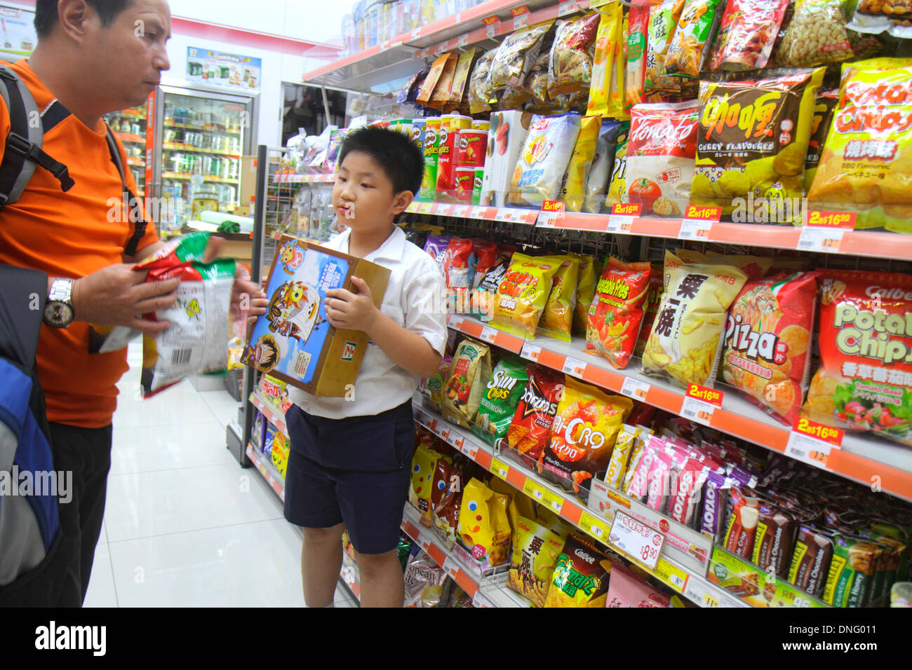 Hong Kong China Island North Point Java Road Wellcome Supermarket grocery store shopping sale display shelves bags potato chips - Stock Image