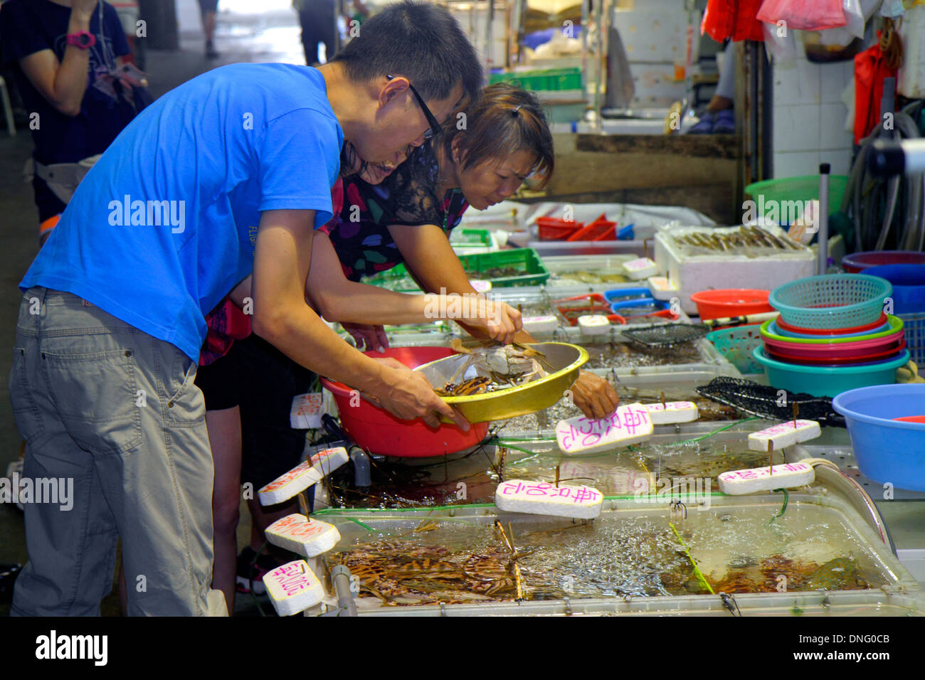 Hong Kong China Island North Point Java Road North Point Ferry Pier fish vendor monger live seafood tanks sale display Stock Photo