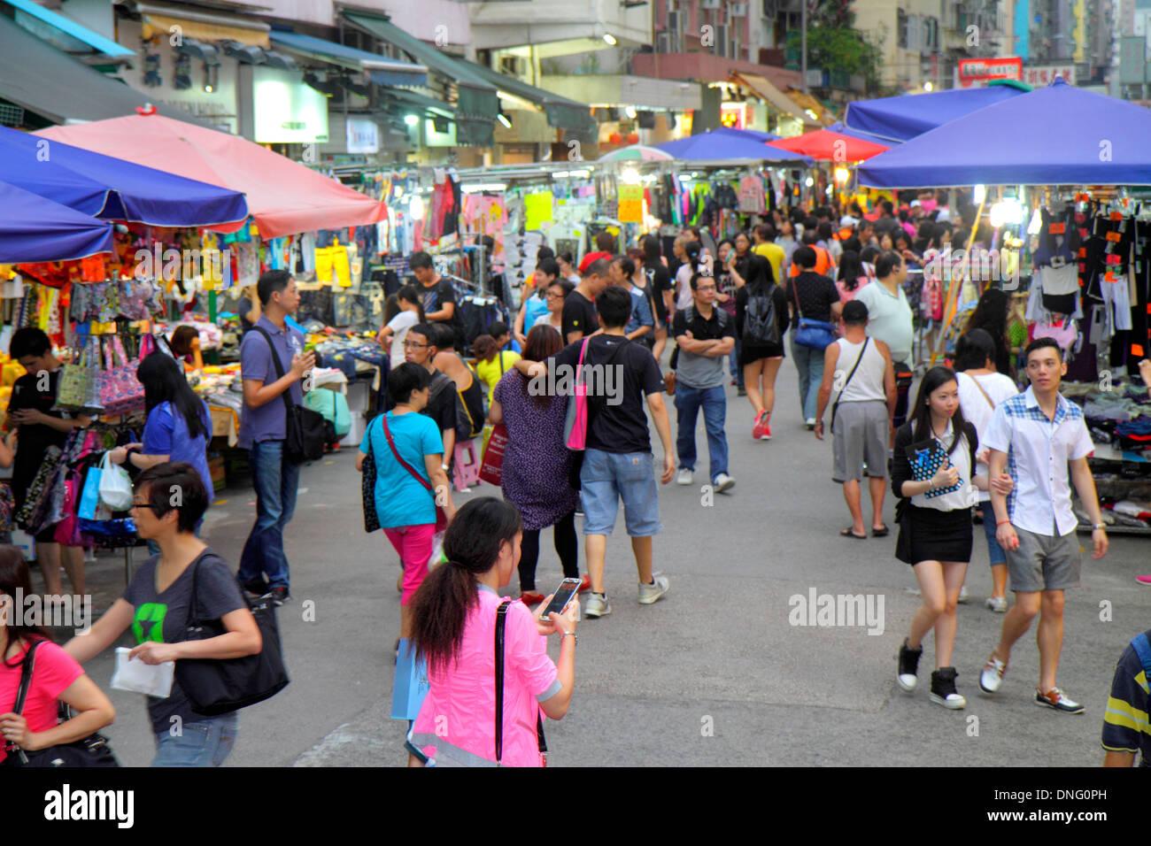 Hong Kong China Kowloon Prince Edward Fa Yuen Street Market shopping pedestrians vendors stalls sale display buying selling Asia - Stock Image