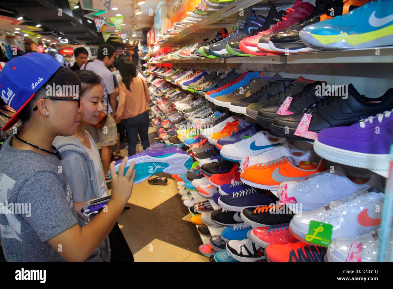 Hong Kong China Kowloon Mong Kok Fa Yuen Street Sneaker Street shopping fashion athletic shoe store inside sale display Asian te - Stock Image