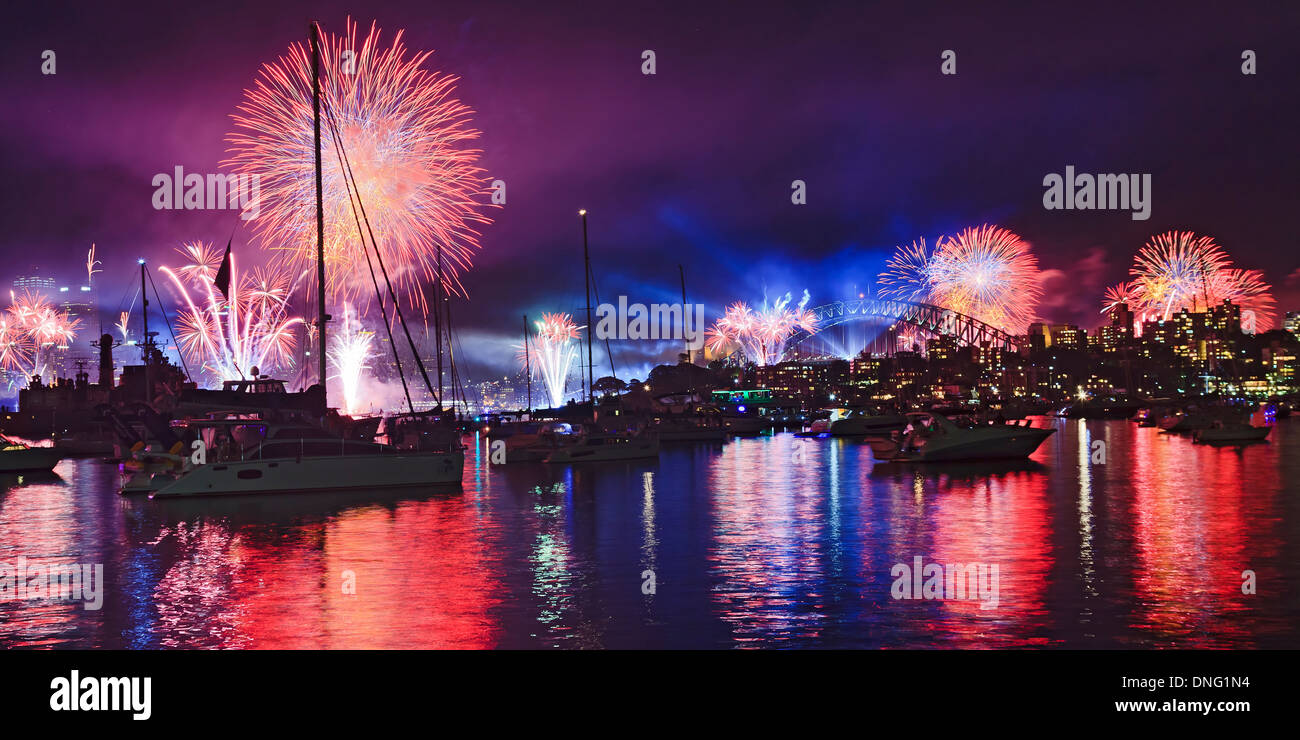 Australia Sydney Harbour water fireworks New Year eve over anchored boats fire balls and light show lasers in the sky - Stock Image