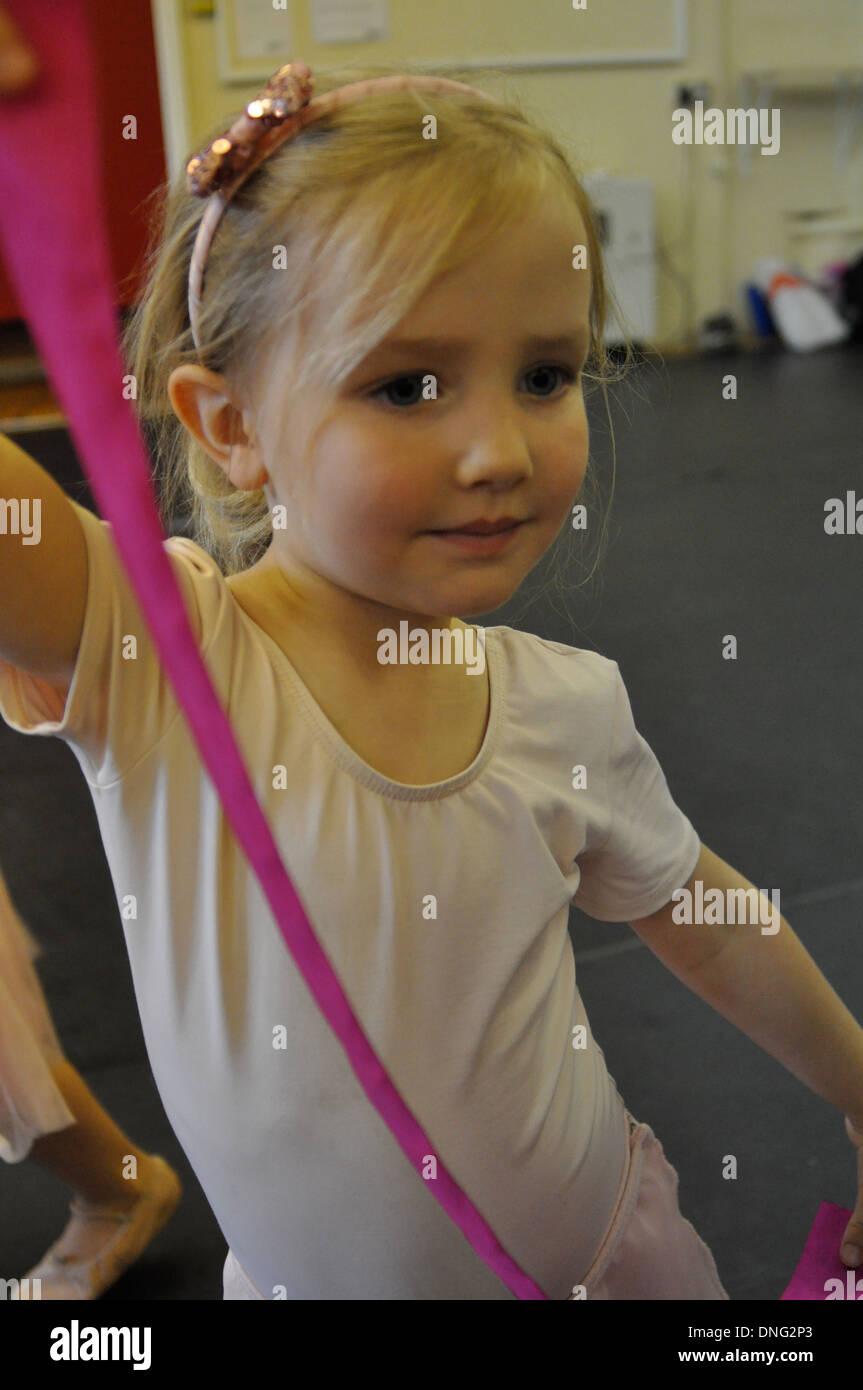 little blonde girl does ballet - Stock Image
