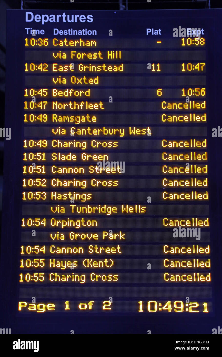London, UK. 27th Dec, 2013. Train notification boards showing trains delayed and cancelled due to bad weather at London Bridge Station, London, England Credit:  Paul Brown/Alamy Live News - Stock Image
