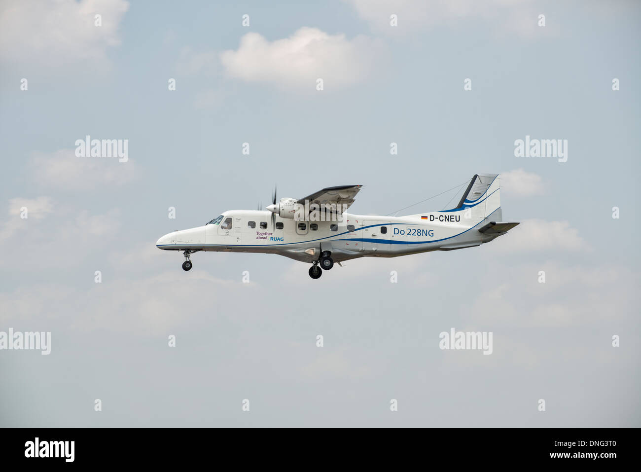 A Dornier 228 from the Ruag organization taxis arriving at RAF Fairford  for the 2013 Royal International Air Tattoo. - Stock Image