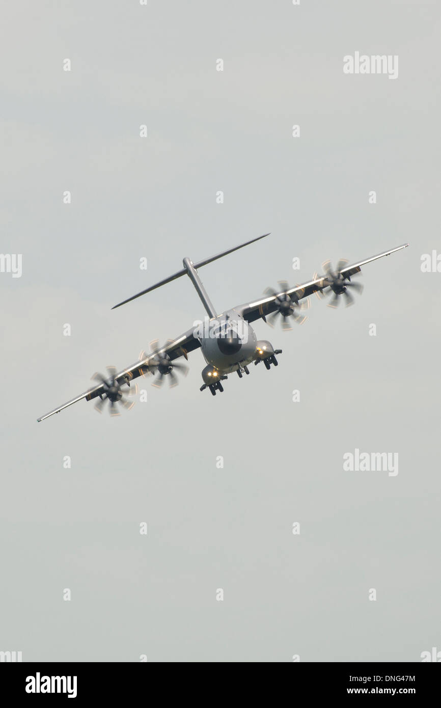 Airbus A400M Atlas F-WWMZ flies over RAF Fairford airbase in Gloucestershire England at the 2013 RIAT - Stock Image