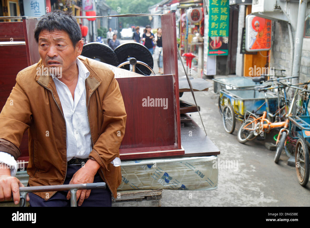beijing stock man shopping hauling images nanluoguxiang tricycle furniture cart district china dongcheng photos photo hutong alamy asian historic