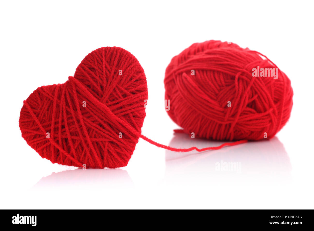 Yarn of wool in heart shape symbol - Stock Image