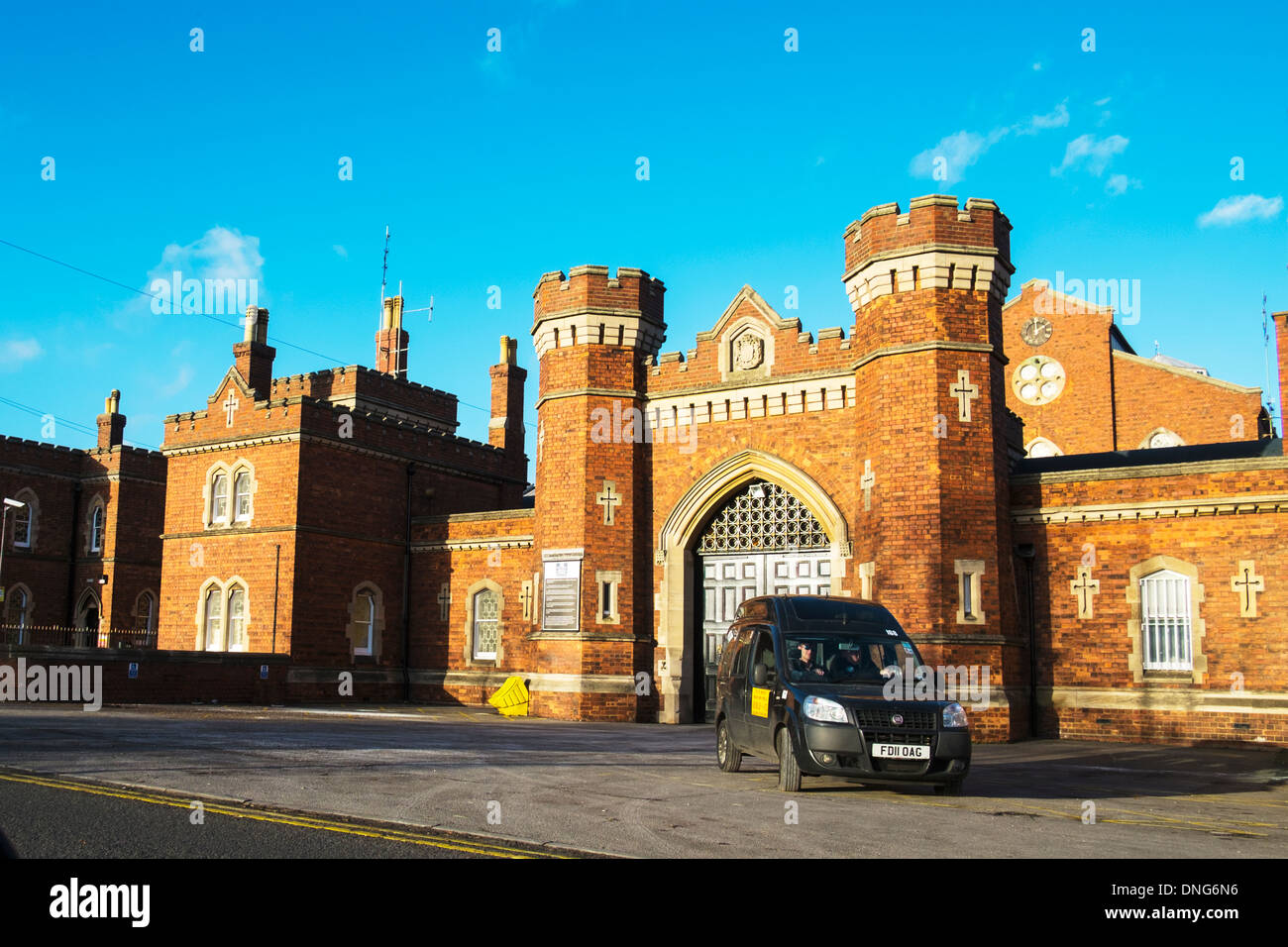 The entrance gates to HMP Prison Lincoln Lincolnshire England UK front facade gate outside building - Stock Image