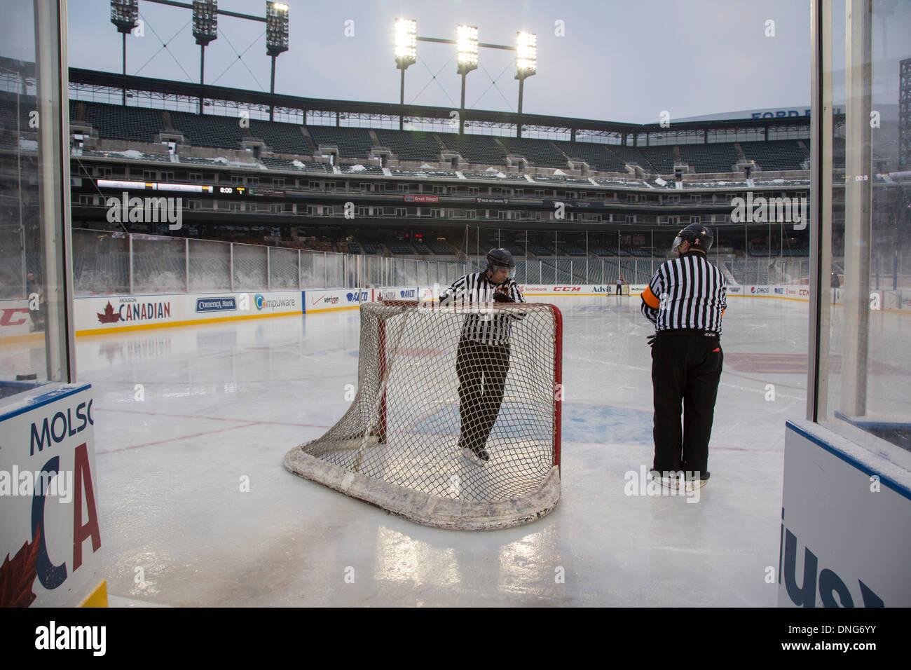 Referees Prepare Nets for High School Girls Ice Hockey - Stock Image