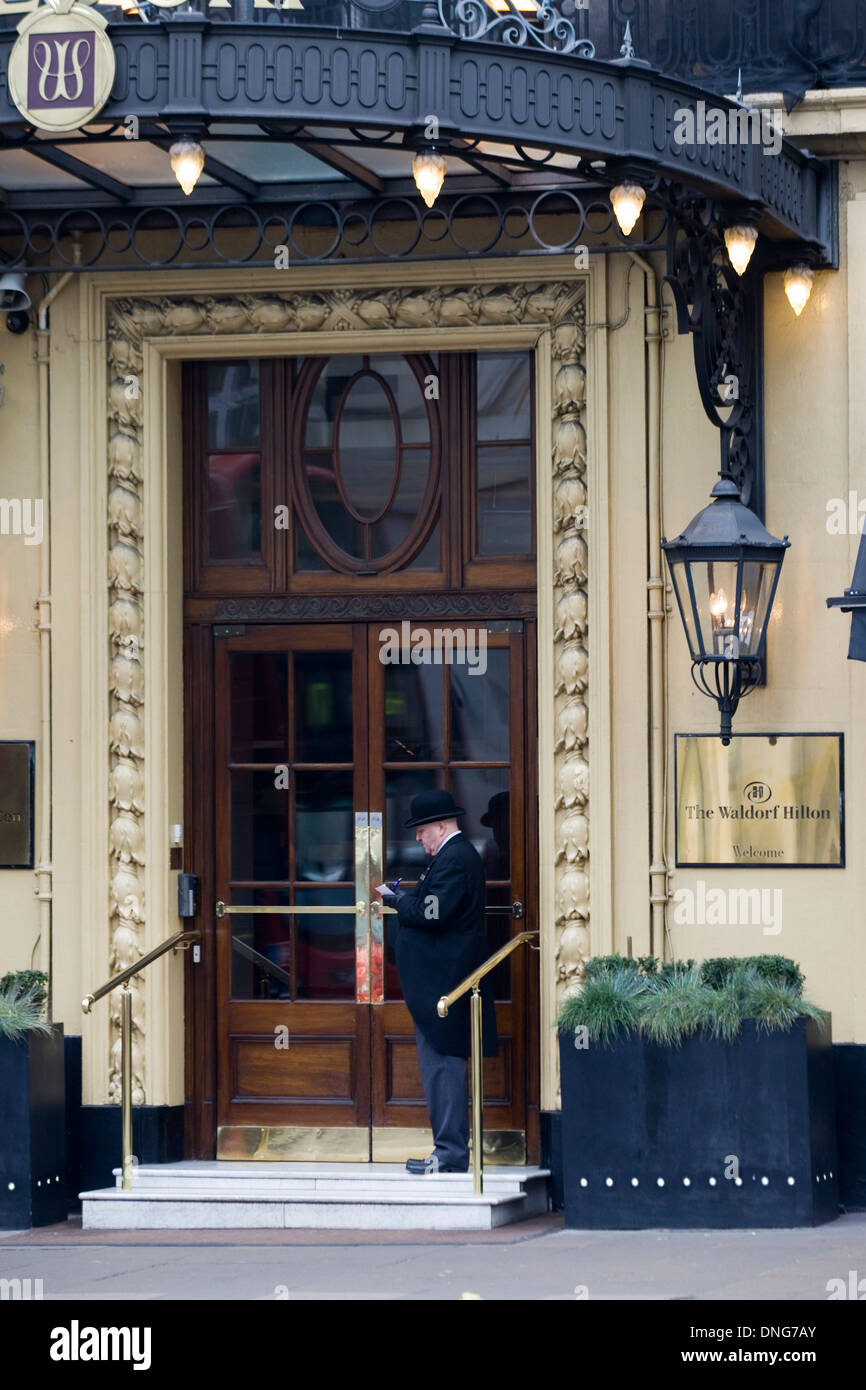 Doorman at the Waldorf Hilton in London England - Stock Image