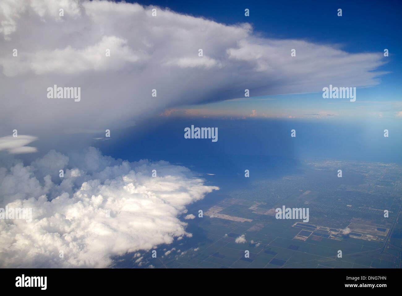 MiamiMiami Florida International Airport MIA US Airways flight window seat aerial view anvil shaped cumulonimbus storm cloud bl - Stock Image
