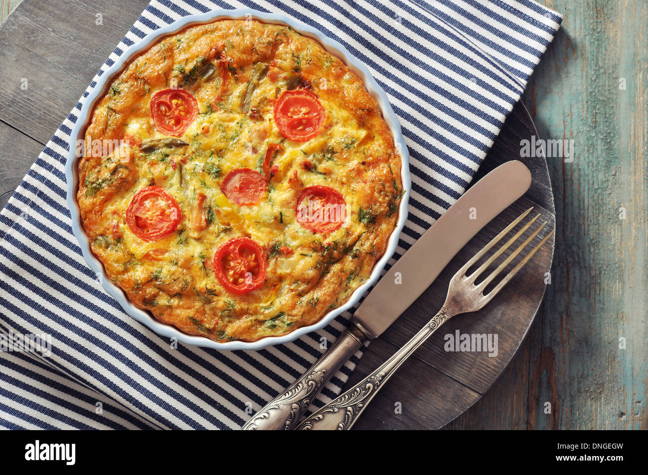 Frittata with Fresh Vegetables and chicken meat in baking mold - Stock Image