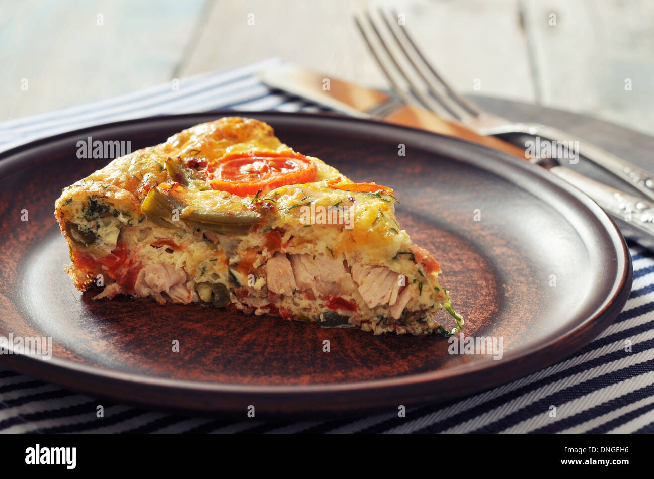 Frittata with Fresh Vegetables and chicken meat on plate - Stock Image