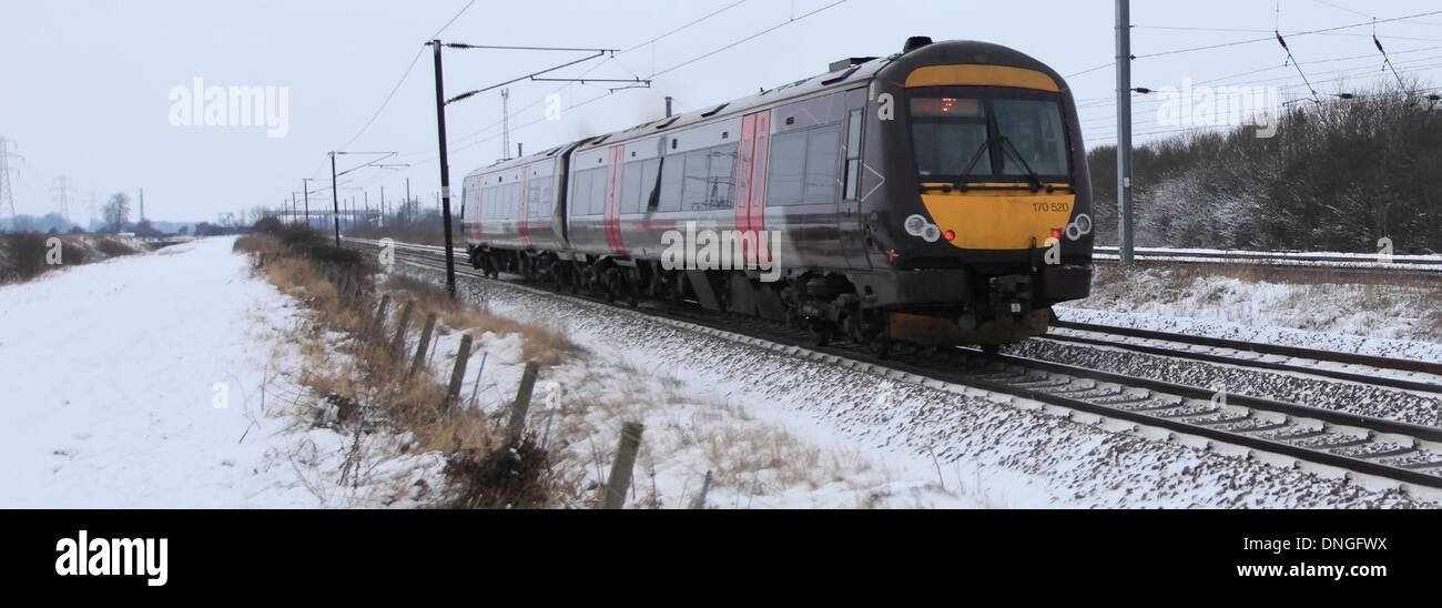 Winter Snow, 170520 County 2 County trains, Turbostar class, High Speed Diesel Train East Coast Main Line Railway Cambridgeshire - Stock Image
