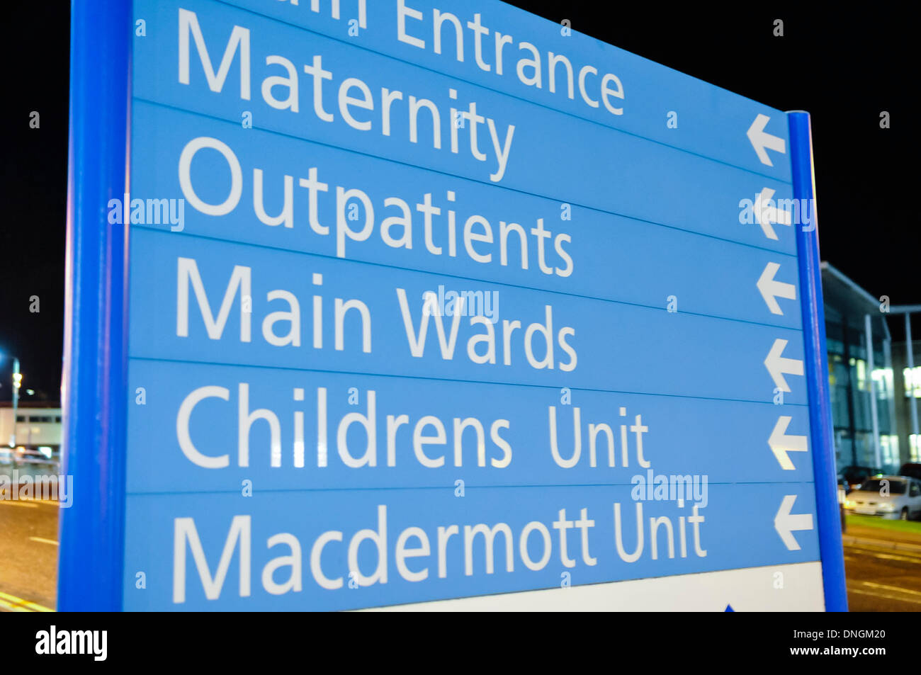 Sign at a hospital for maternity, outpatients, main wards, childrens unit and the Macdermott Unit. - Stock Image