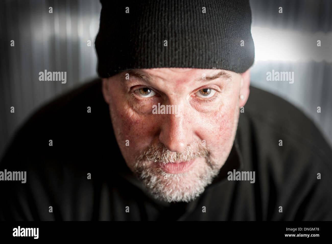 White male man cap face portrait photograph - Stock Image