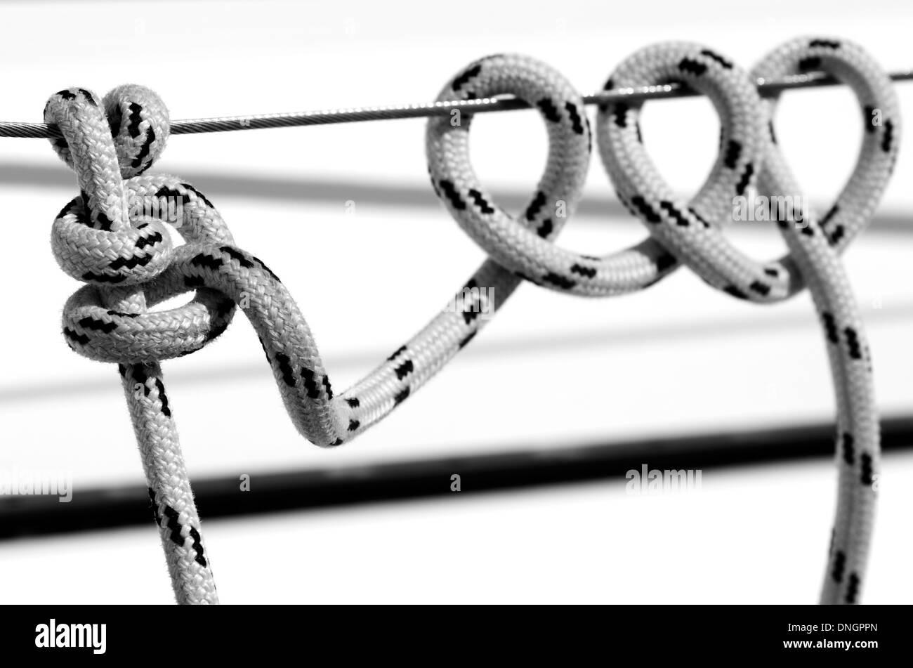 Marine knot detail on stainless steel boat railing banister - Stock Image