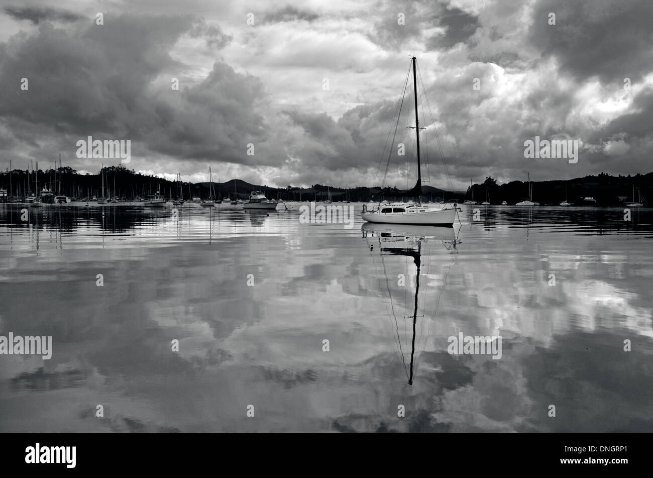 Reflection of sails boats yachts in marina waters under cloudy sky. (BW) Stock Photo