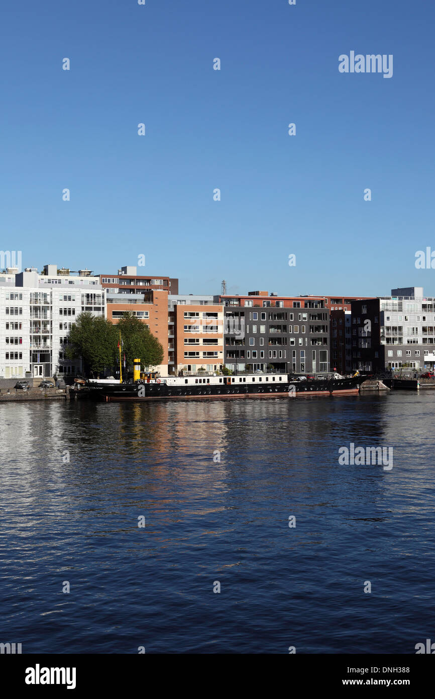 The River Ij by Java Island (Java Island) in Amsterdam, Netherlands. - Stock Image