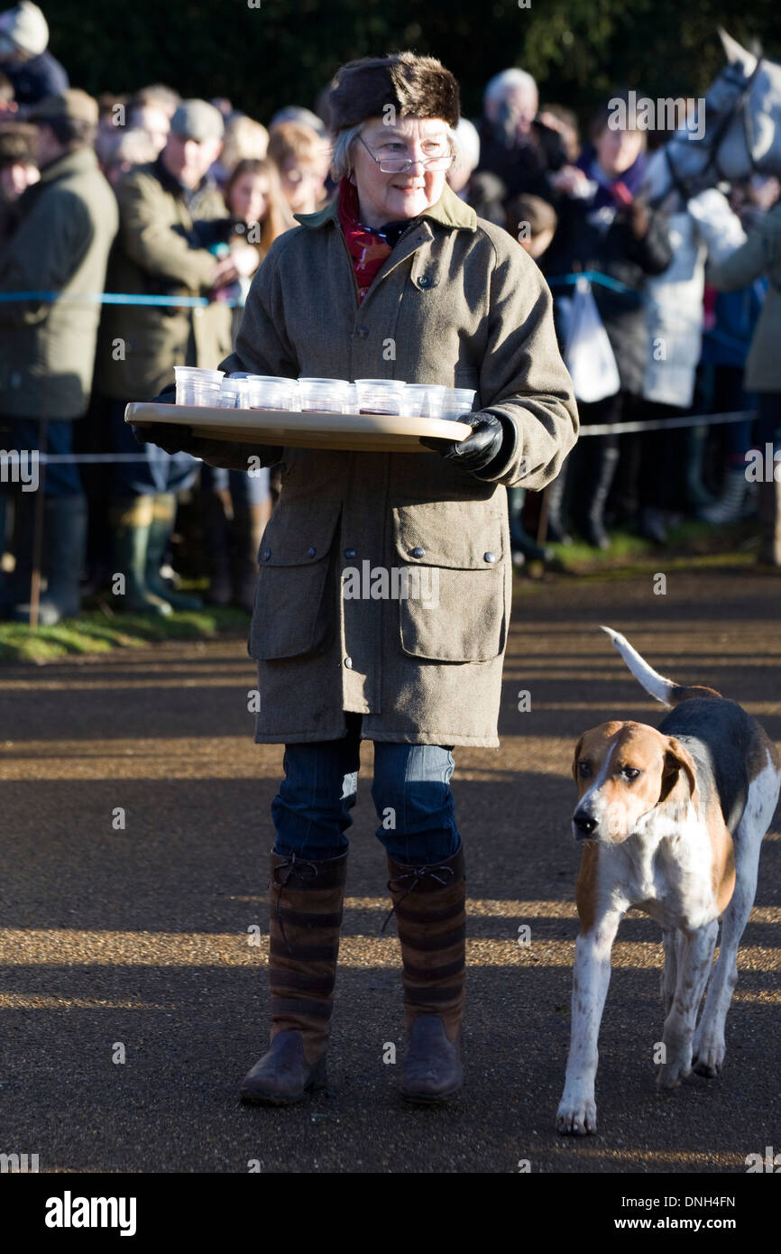 Lady giving drinks of port at the boxing Day hunt with Fox Hound at Heel - Stock Image