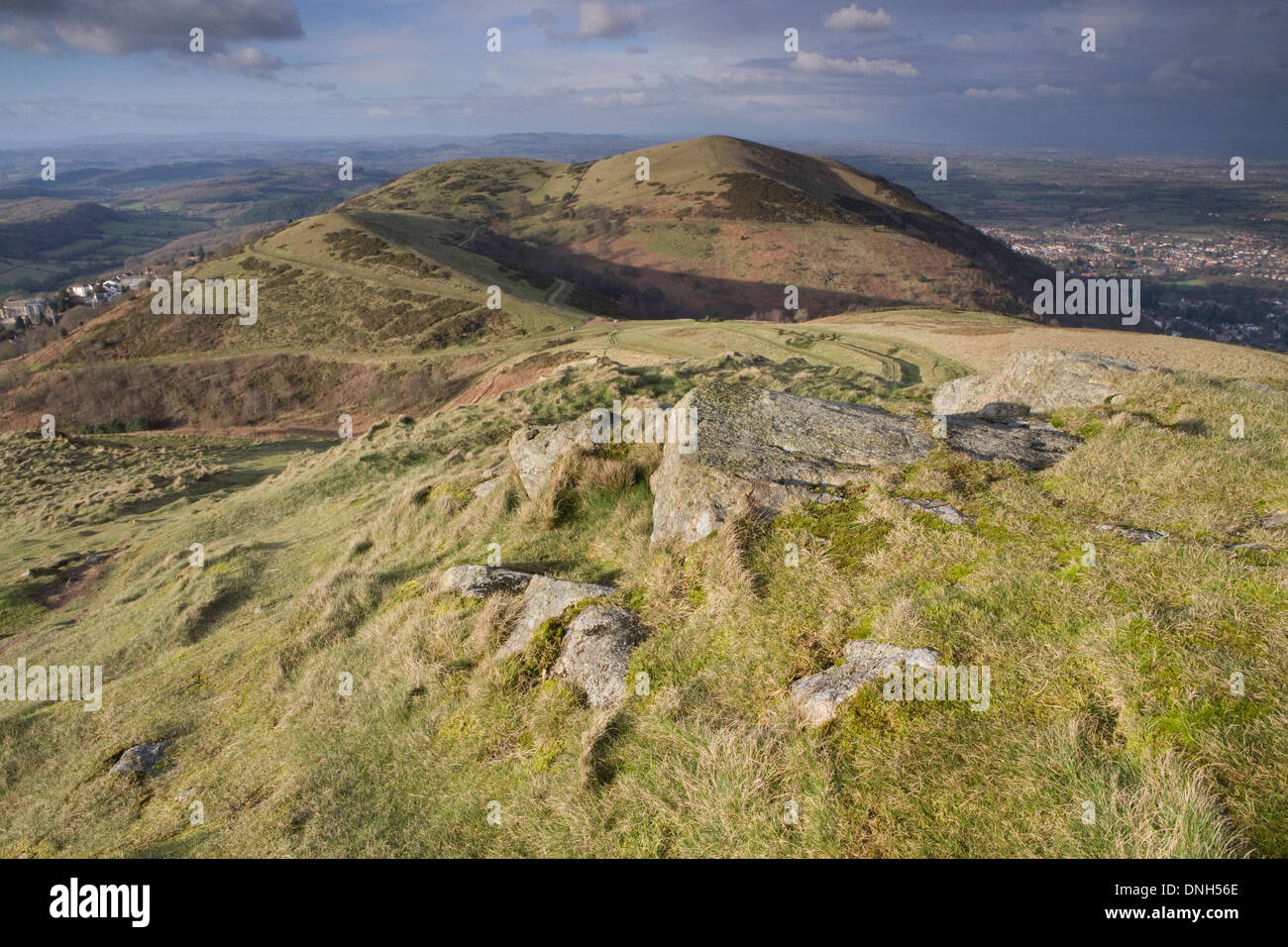 One of the many exposed rocks on the Worcestershire Beacon on the Malvern Hills, Worcestershire, in the Spring at Stock Photo