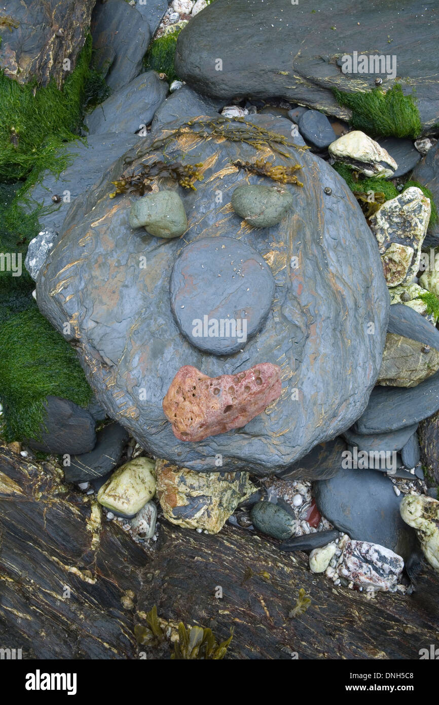 Pebbles on the beach at Hope Cove, Devon, make a smiley face. Stock Photo
