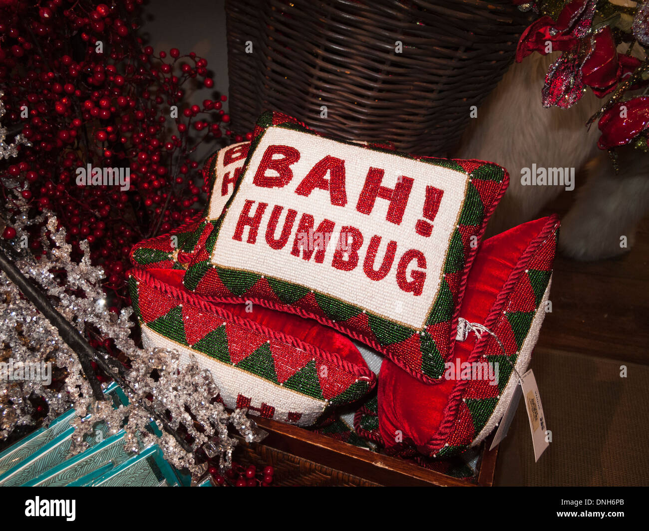 'Bah humbug' red, white and green beaded Christmas decoration cushion - Stock Image