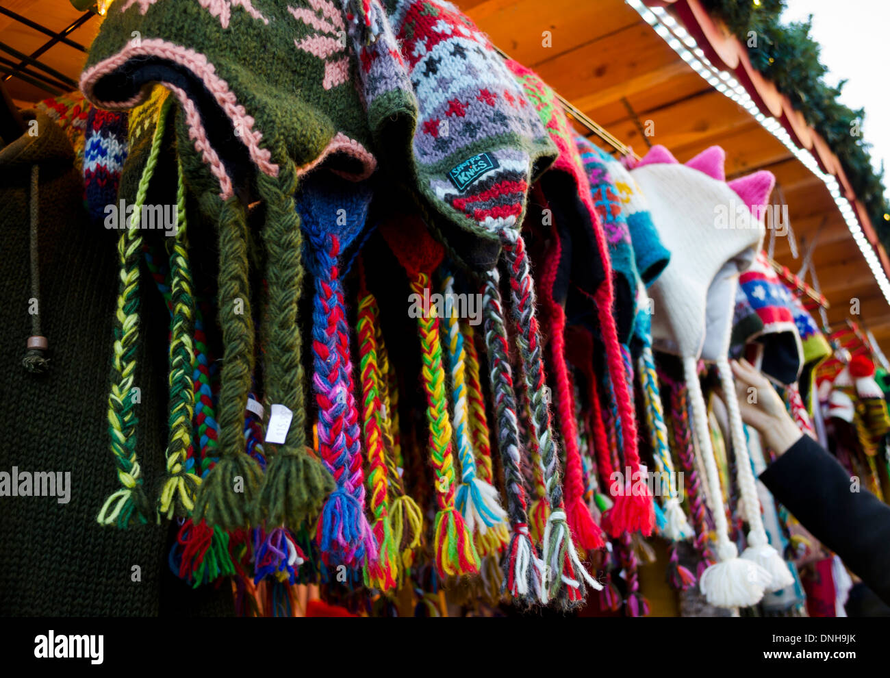 A selection of colourful sherpa hats, sold at the Sherpa Knits booth at the Vancouver Christmas market. - Stock Image