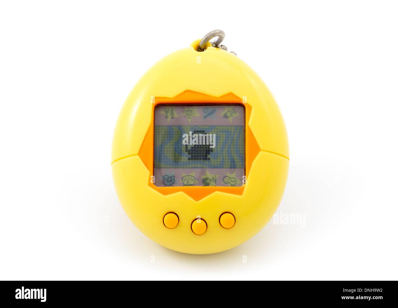 Original Tamagotchi たまごっち toy digital pet aka Tamagotch by Bandai 1996 - Stock Image