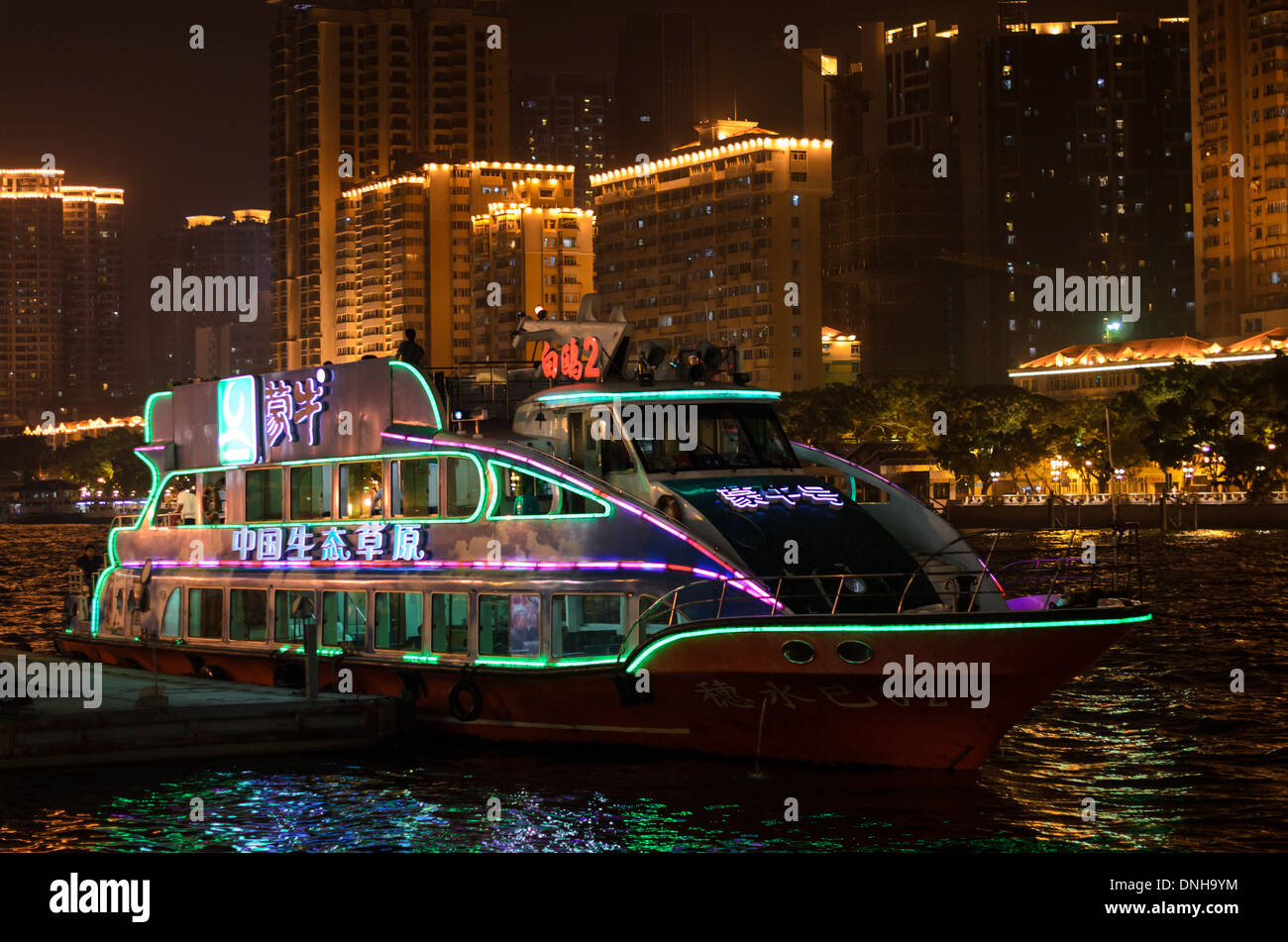 Chinese tourist boat used for night time sightseeing along a major river. - Stock Image