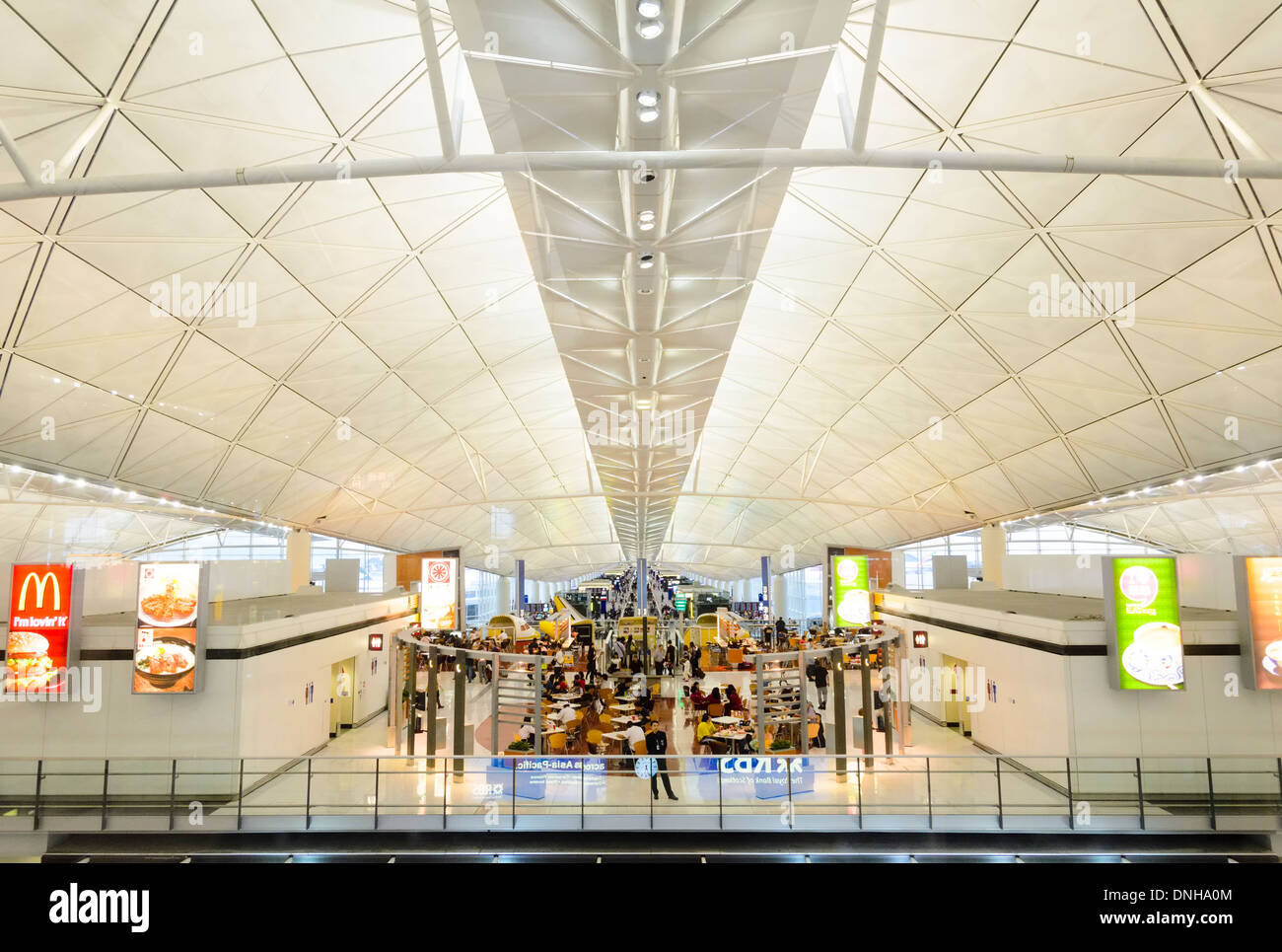 Modern international contemporary airport passenger concourse building ceiling / roof: Hong Kong International Airport. - Stock Image