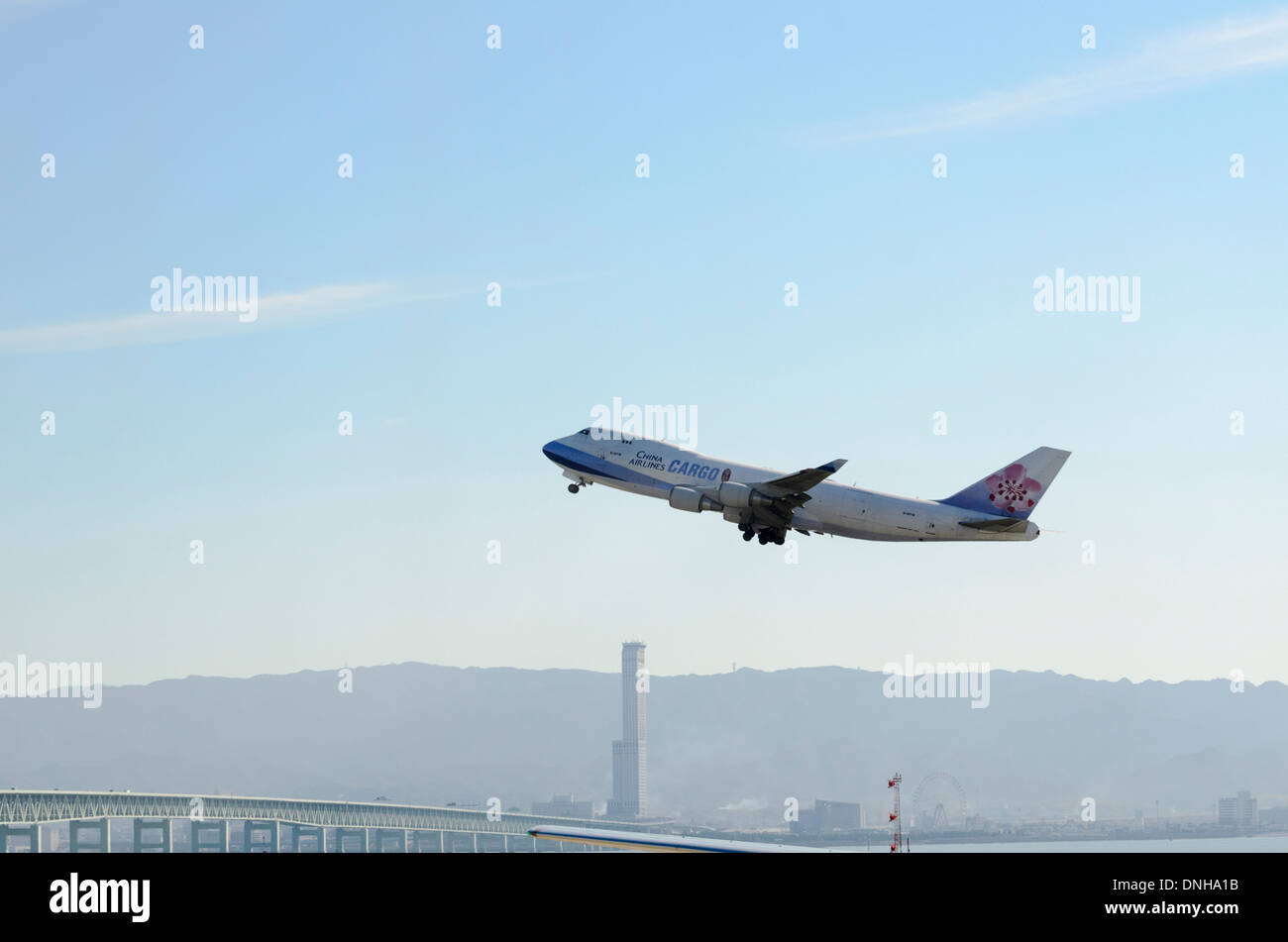 Old Jumbo Jet (Boeing 747) operating as a freighter, taking off from an airport Stock Photo