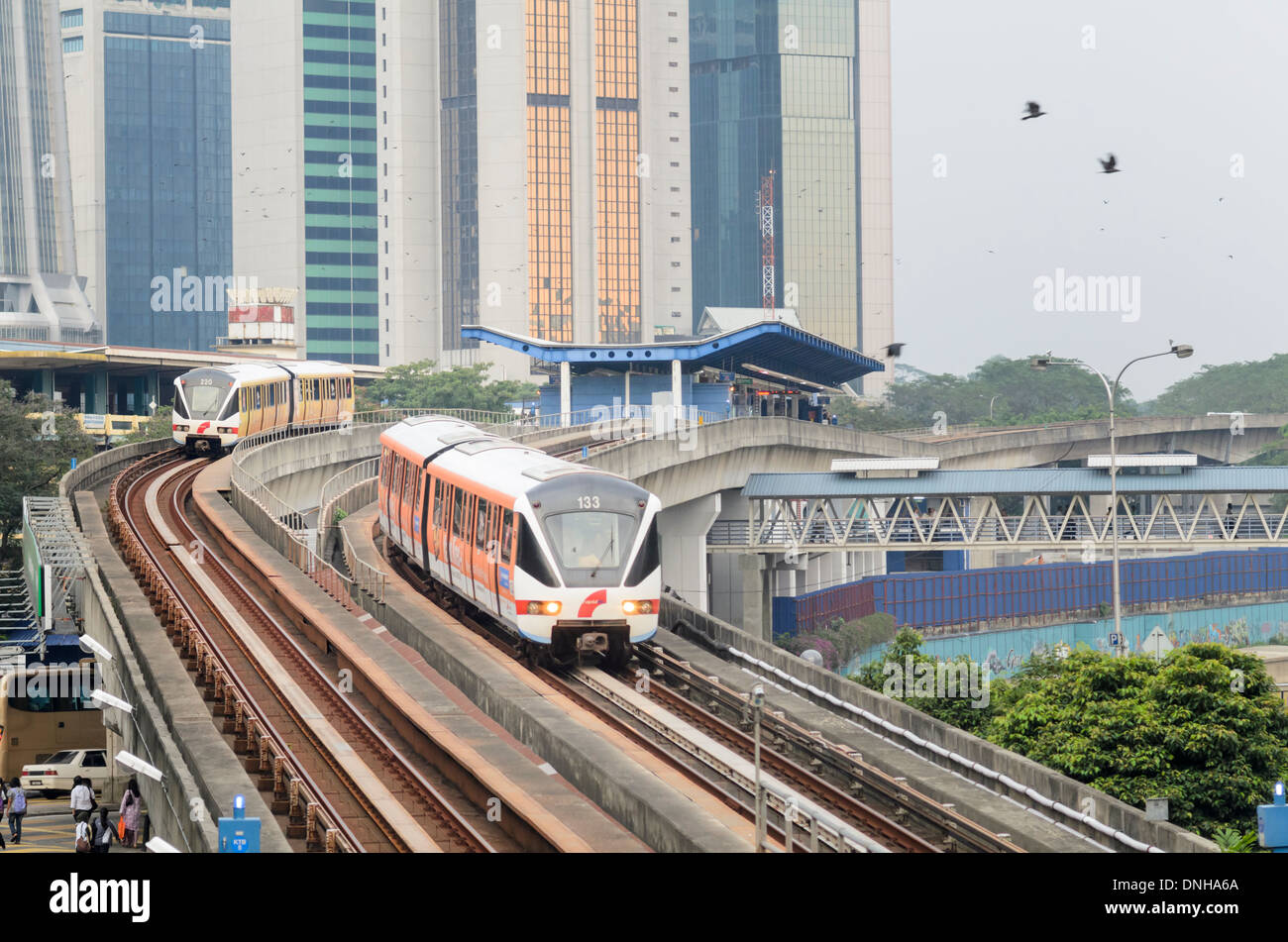 Modern Asian transport infrastructure: driverless commuter trains, elevated tracks and station Stock Photo