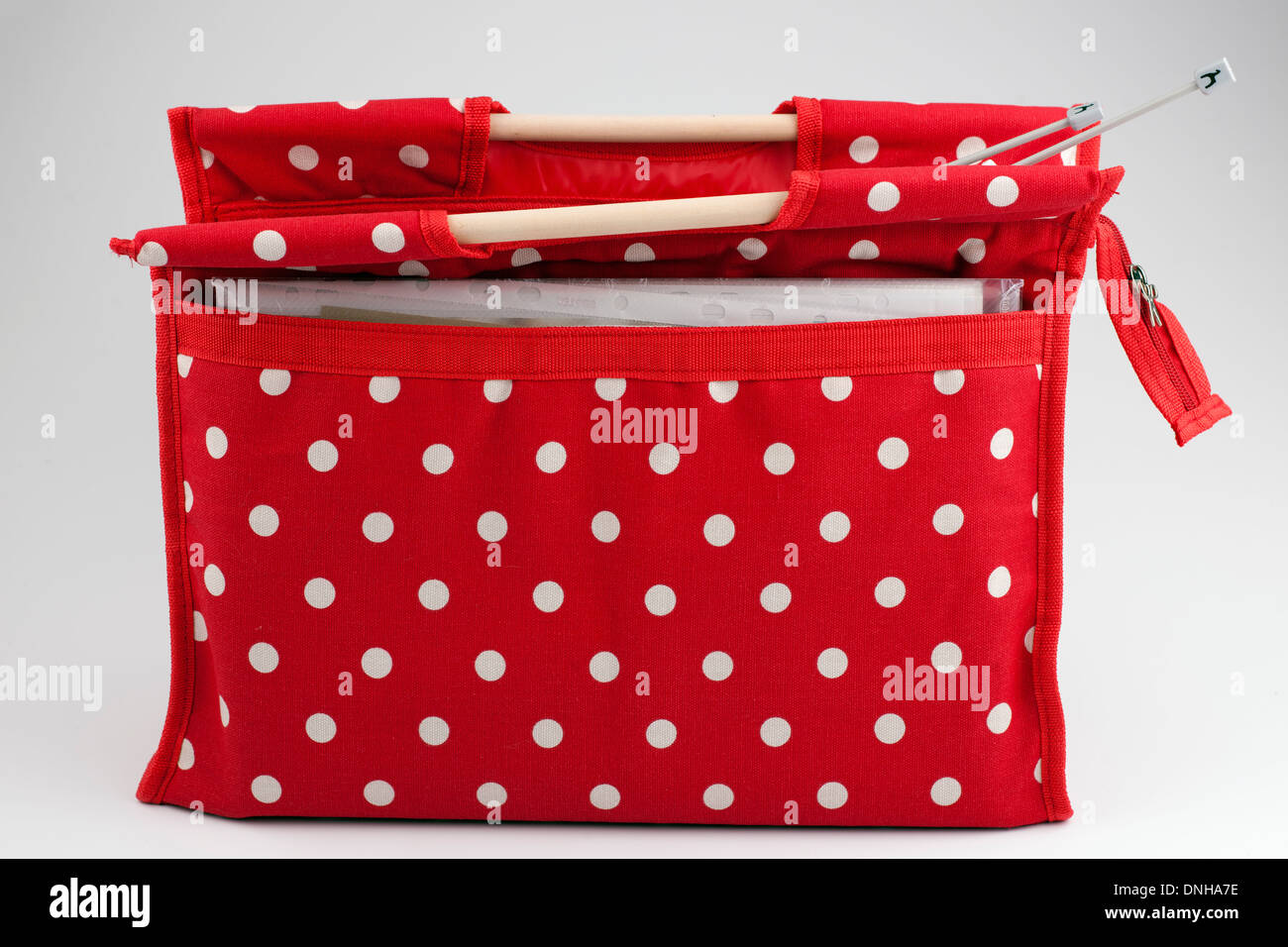 Red and white spotted zipped knitting bag - Stock Image