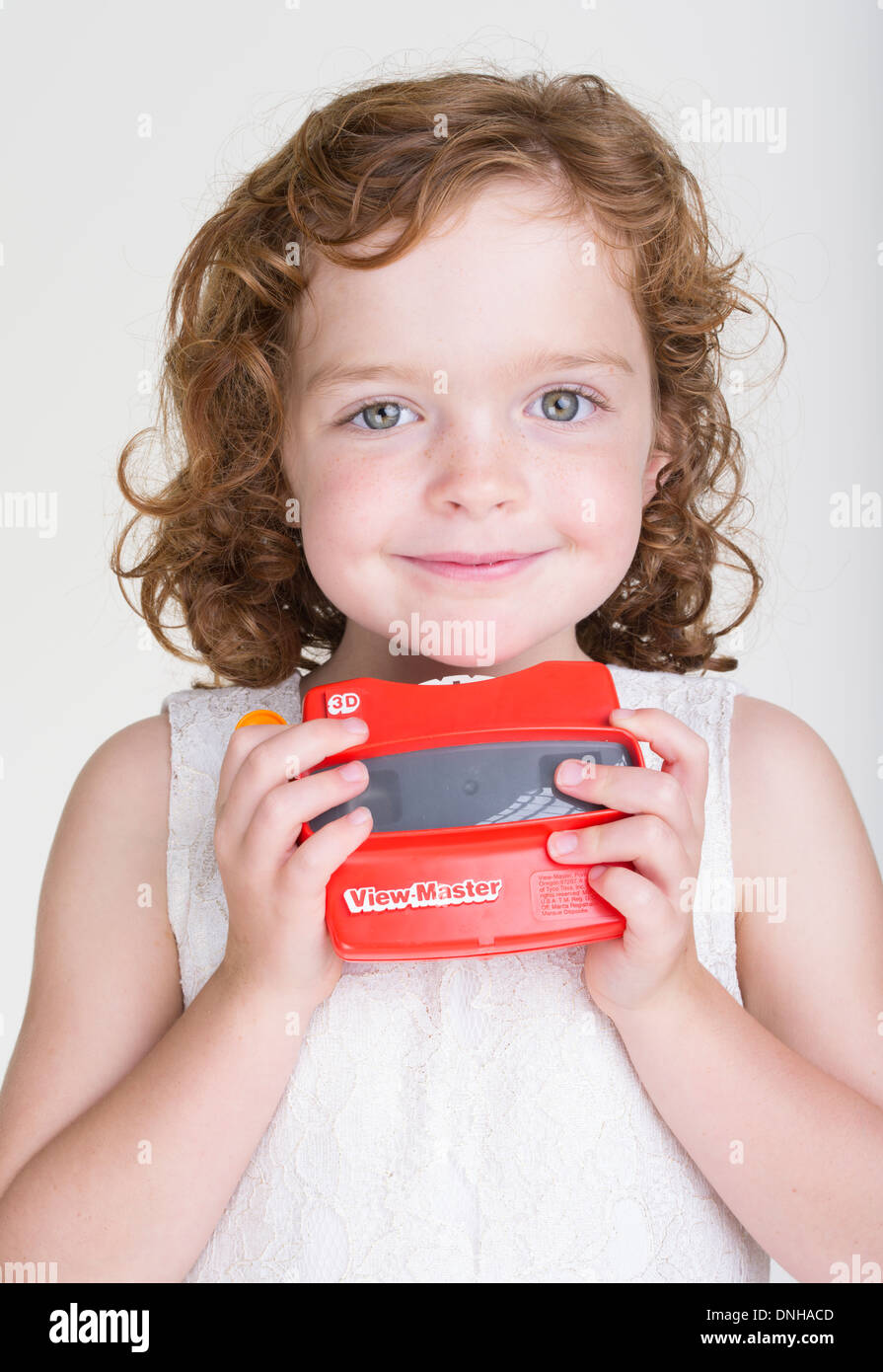 Young girl with View-Master stereoscopic 3-D 3D viewer Stock Photo