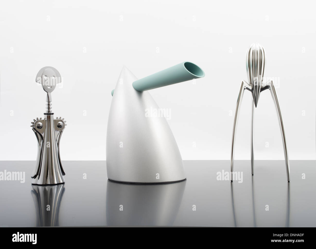 Anna G. Corkscrew, HOT BERTAA / Water Kettle, Alessi Juicy Salif Citrus Squeezer  Designed by Philippe Starck for Alessi. - Stock Image