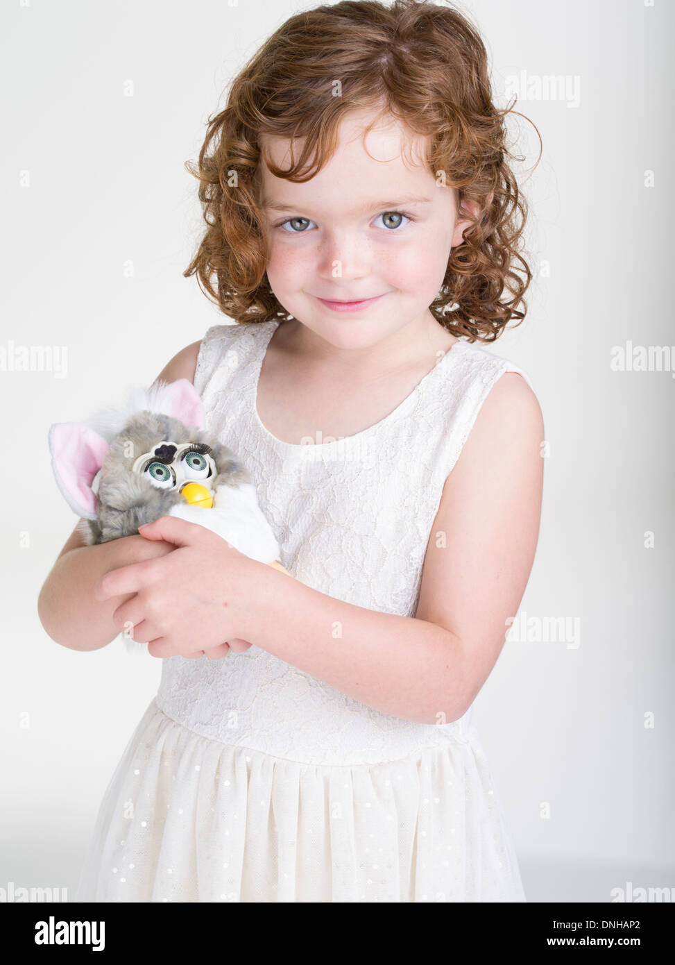 Young Girl with 1998 Furby electronic robotic toy by Tiger Electronics - Stock Image