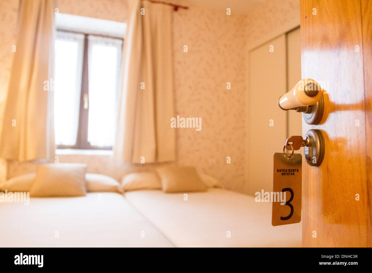Bedroom in a hotel - Stock Image
