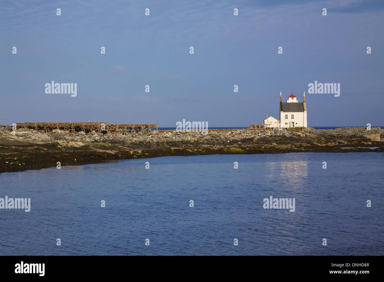 Scenic old norwegian lighthouse in port of Sorland on island Vaeroy, Lofoten, Norway - Stock Image