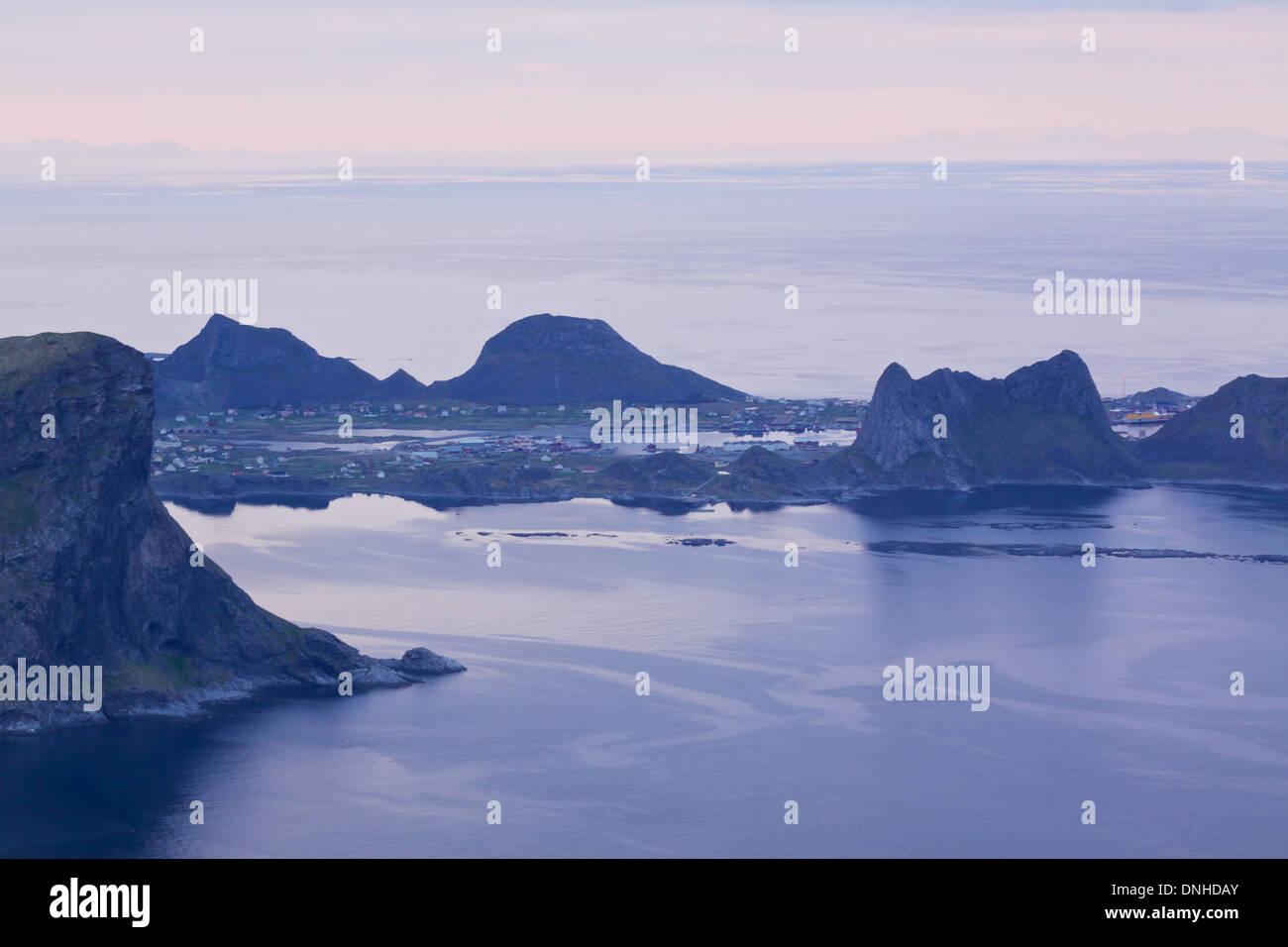 Fishing port Sorland on remote island of Vaeroy on Lofoten, Norway during night in summer - Stock Image