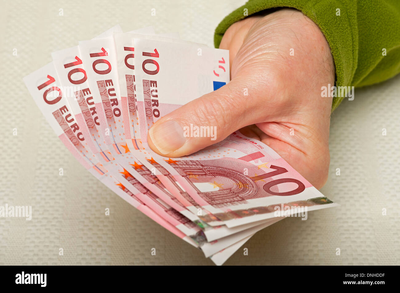 Hand holding 10 Euro notes - Stock Image