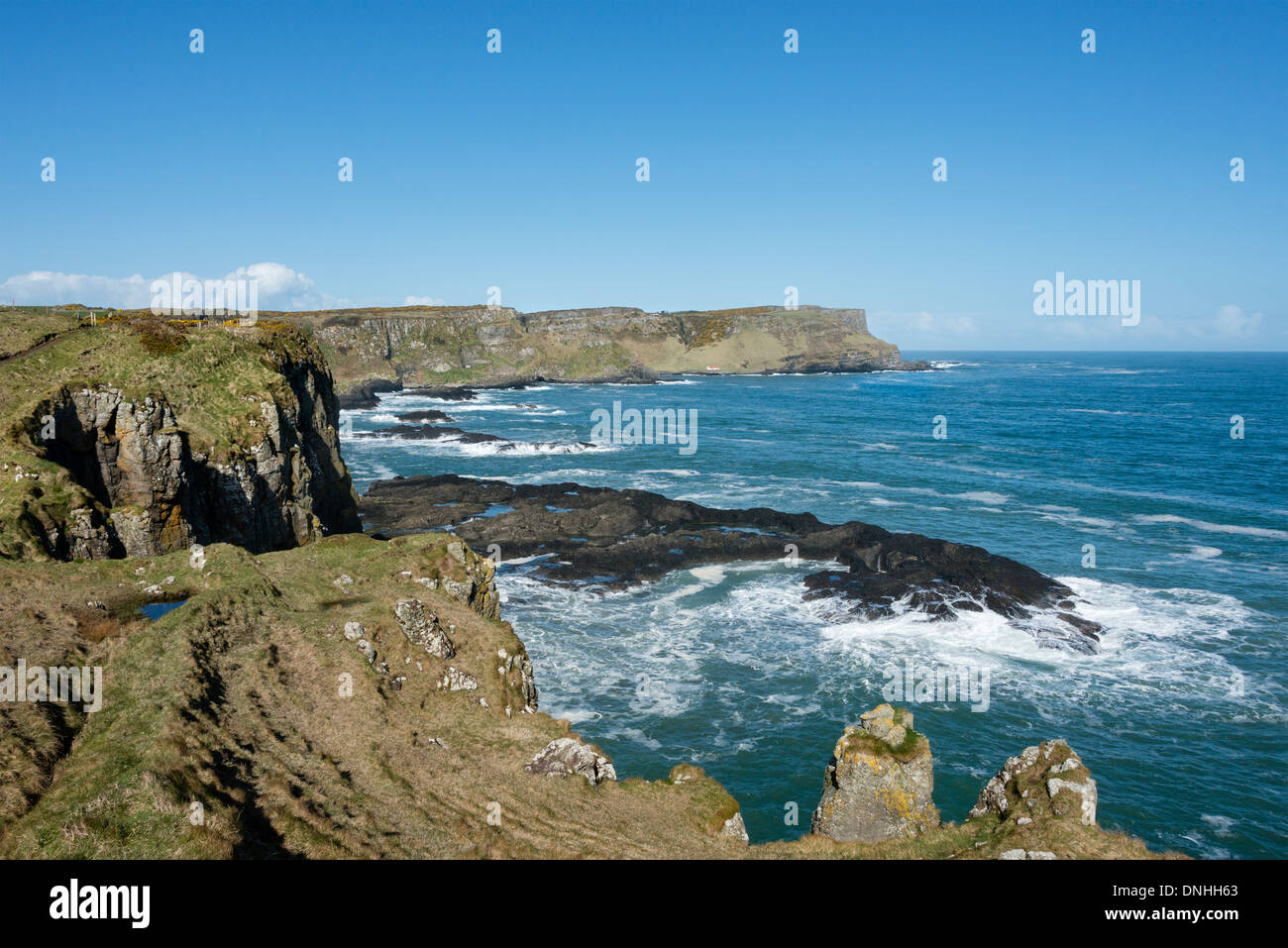 Causeway Coast Way looking west towards Port Moon and Contham Head. - Stock Image