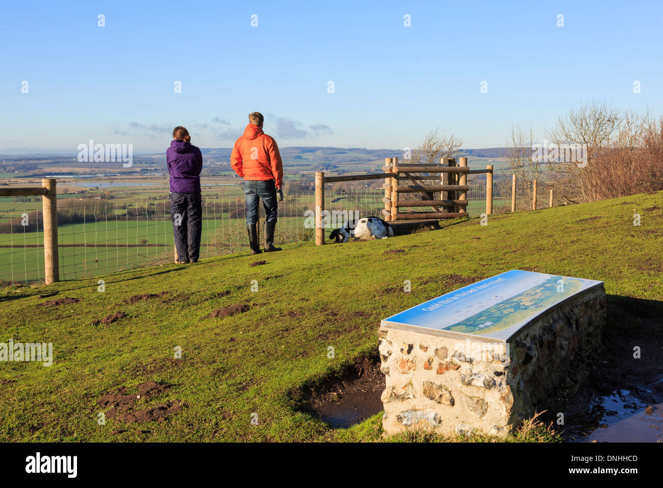 Two people enjoying view looking west from viewpoint in Wye National Nature Reserve hills on North Downs Way Kent England UK Britain - Stock Image