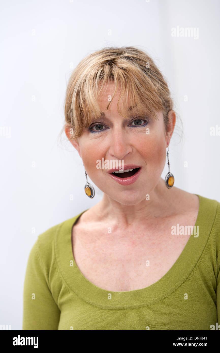 Astonished senior woman on white background - Stock Image